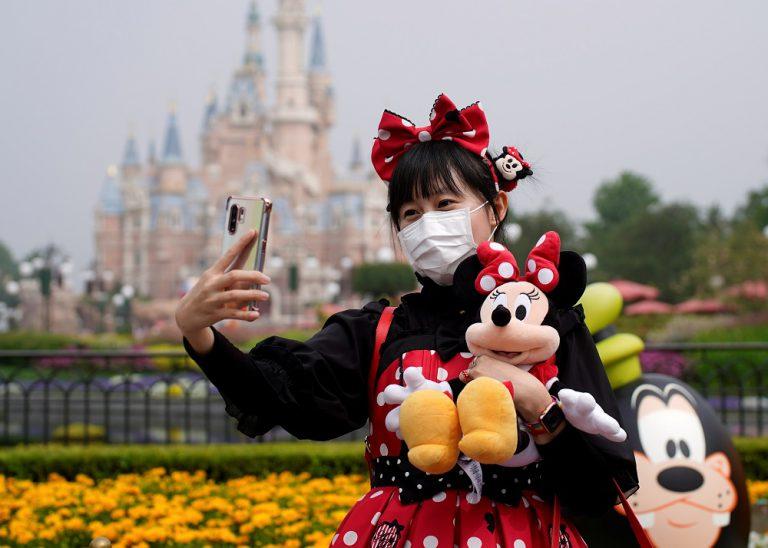 Paris salons, Shanghai Disney reopen despite global alarm over second coronavirus wave